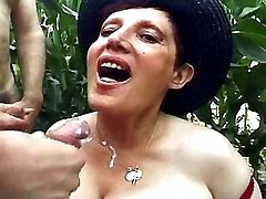 Old slut gets cum on chest outdoors